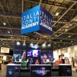 two tier stand with large cube branding banner